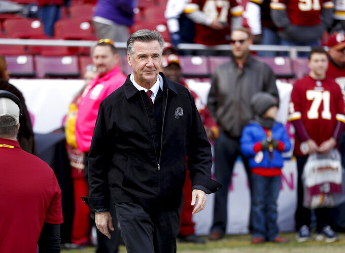 FILE - In this Oct. 21, 2018 file photo, Washington Redskins President Bruce Allen walks across the field before an NFL football game against the Dallas Cowboys in Landover, Md. Allen was fired Monday, Dec. 30, 2019, after a tumultuous and loss-filled decade with the NFL team once coached by his father.  (AP Photo/Andrew Harnik, File)