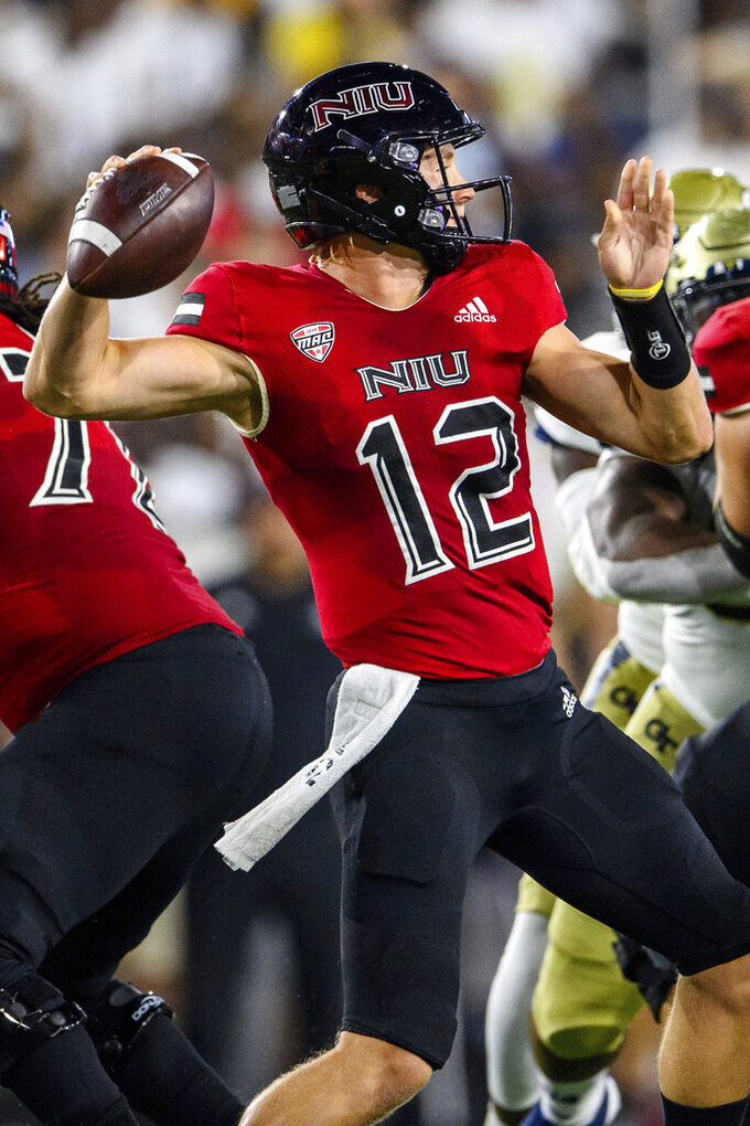 Northern Illinois quarterback Rocky Lombardi (12) throws during the first half of an NCAA college football game against Georgia Tech on Saturday, Sept. 4, 2021, in Atlanta. (AP Photo/Danny Karnik)