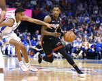 Miami Heat Josh Richardson, right, drives past Oklahoma City guard Terrance Robinson, right, in the first half of an NBA basketball game , Monday, March 18, 2019, in Oklahoma City. (AP Photo/Kyle Phillips)