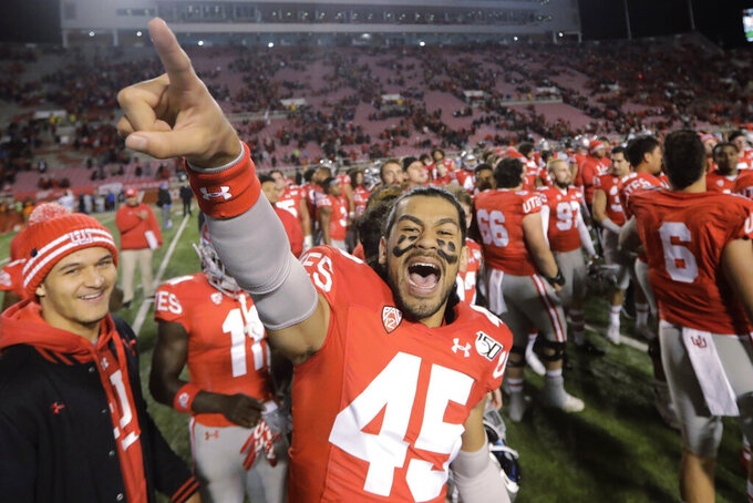Utah wide receiver Samson Nacua (45) celebrates their victory over UCLA following their NCAA college football game Saturday, Nov. 16, 2019, in Salt Lake City. (AP Photo/Rick Bowmer)