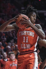 Illinois' Ayo Dosunmu brings down a rebound against Michigan State in the second half of an NCAA college basketball game Tuesday, Feb. 11, 2020, in Champaign, Ill. (AP Photo/Holly Hart)