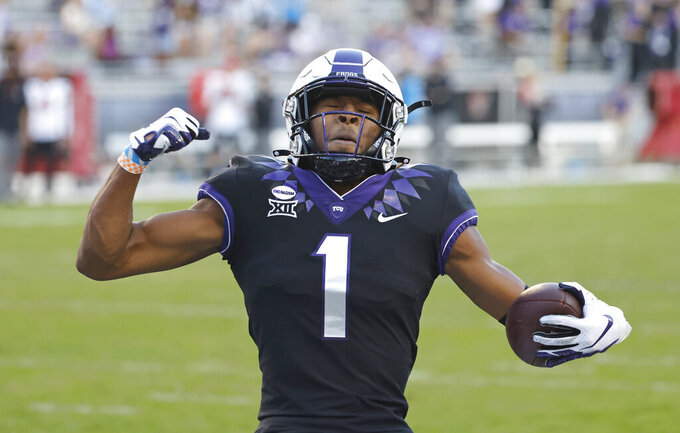 TCU wide receiver Quentin Johnston (1) celebrates after scoring a touchdown against Texas Tech during the second half of an NCAA college football game Saturday, Nov. 7, 2020, in Fort Worth, Texas. TCU won 34-18. (AP Photo/Ron Jenkins)