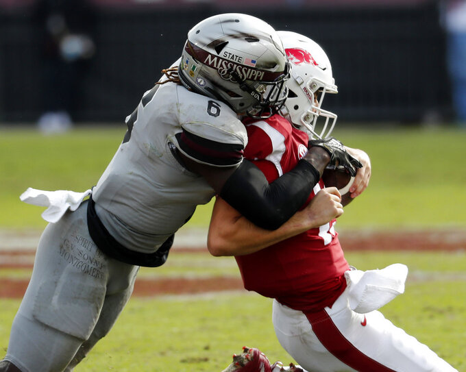 Mississippi State linebacker Willie Gay Jr. (6) sacks Arkansas quarterback Connor Noland (13) during the second half of an NCAA college football game in Starkville, Miss., Saturday, Nov. 17, 2018. Mississippi State won 52-6. (AP Photo/Rogelio V. Solis)