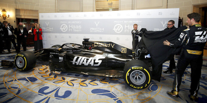 A general view of the new livery being unveiled by drivers Kevin Magnussen and Romain Grosjean  during the Rich Energy Haas F1 Team 2019 car launch at the Royal Automobile Club, in London, Thursday, Feb. 7, 2019. (Steven Paston/PA via AP)