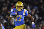 FILE - In this Nov. 30, 2019, file photo, UCLA running back Joshua Kelley runs the ball during the first half of an NCAA college football game against California in Pasadena, Calif. The Los Angeles Chargers selected Kelley in the fourth round of the NFL football draft on Saturday, April 25, 2020. (AP Photo/Mark J. Terrill, File)