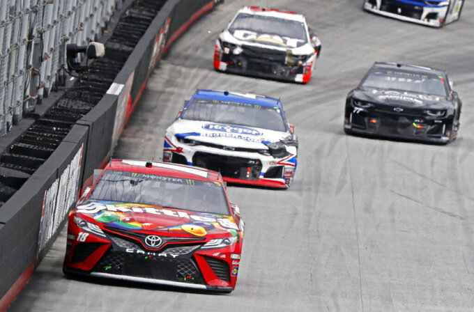 Kyle Busch (18) leads Ryan Preece (47), Quin Houff (77) and Daniel Hemric (8) down the back stretch during a NASCAR Cup Series auto race, Sunday, April 7, 2019, in Bristol, Tenn. (AP Photo/Wade Payne)