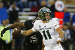 South Florida quarterback Blake Barnett (11) throws in the first half of an NCAA college football game against Tulsa in Tulsa, Okla., Friday, Oct. 12, 2018. (AP Photo/Sue Ogrocki)