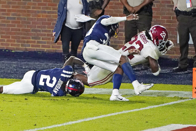 Alabama running back Najee Harris (22) dives past an attempted tackle by Mississippi defensive back Jalen Jordan (2) into the end zone for a touchdown during the second half of an NCAA college football game in Oxford, Miss., Saturday Oct. 10, 2020. Alabama won 63-48. (AP Photo/Rogelio V. Solis)