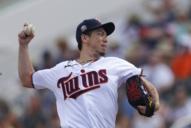 Minnesota Twins starting pitcher Kenta Maeda works in the first inning of a spring training baseball game against the Boston Red Sox Monday, Feb. 24, 2020, in Fort Myers, Fla. (AP Photo/John Bazemore)