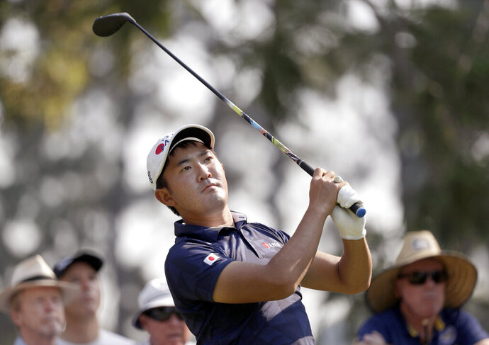 Takumi Kanaya of Japan tees off on the 17th hole during the opening round of the Australian Open Golf tournament in Sydney, Thursday, Dec. 5, 2019. (AP Photo/Rick Rycroft)