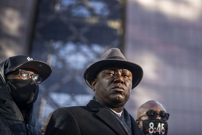 FILE - In this Monday, March 29, 2021 file photo, from left, Terrence Floyd, brother of George Floyd; attorney Ben Crump and Philonise Floyd, brother of George Floyd, hold a news conference at the Hennepin County Government Center in Minneapolis, Minn., on the first day of the Derek Chauvin murder trial. (Jerry Holt/Star Tribune via AP)