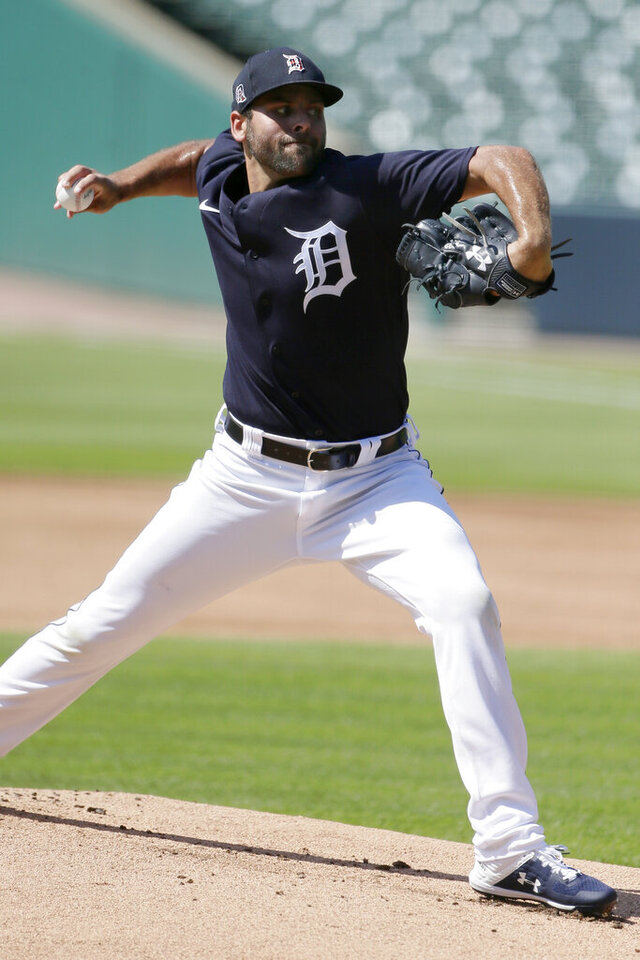 Detroit Tigers' Michael Fulmer pitches from the mound during baseball training camp at Comerica Park, Friday, July 3, 2020, in Detroit. (AP Photo/Duane Burleson)