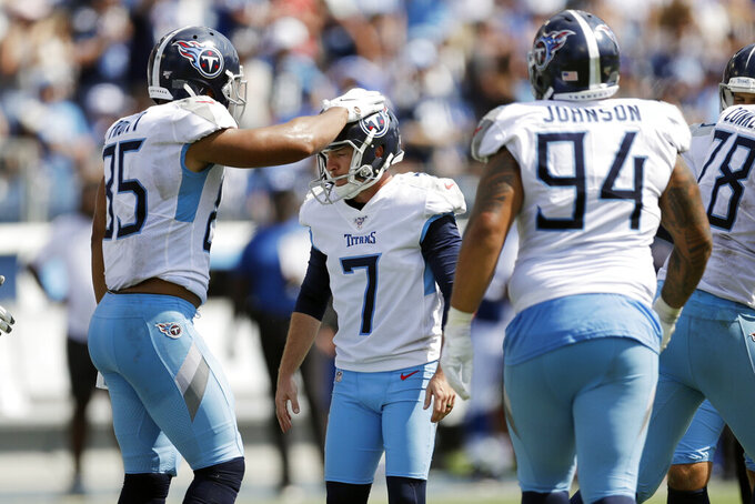Tennessee Titans kicker Cairo Santos (7) is congratulated by MyCole Pruitt (85) after Santos kicked the extra point after a touchdown against the Indianapolis Colts in the second half of an NFL football game Sunday, Sept. 15, 2019, in Nashville, Tenn. (AP Photo/James Kenney)