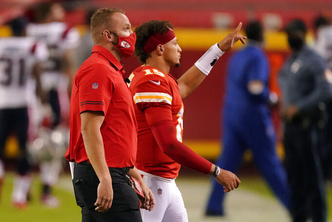 Kansas City Chiefs quarterback Patrick Mahomes, right, walks off the field after an NFL football game against the New England Patriots, Monday, Oct. 5, 2020, in Kansas City. The Chiefs won 26-10. (AP Photo/Charlie Riedel)
