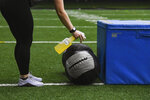 Workout equipment is sanitized after use during high school football workouts, Wednesday, July 8, 2020, at the Sanford Fieldhouse in Sioux Falls, S.D. (Erin Bormett/The Argus Leader via AP)