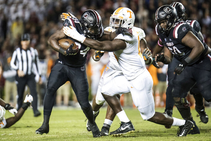 South Carolina running back Mon Denson (34) runs with the ball against Tennessee linebacker Darrell Taylor (19) during the second half of an NCAA college football game Saturday, Oct. 27, 2018, in Columbia, S.C. South Carolina defeated Tennessee 27-24. (AP Photo/Sean Rayford)