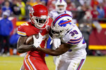 Kansas City Chiefs wide receiver Mecole Hardman (17) catches a pass as Buffalo Bills cornerback Levi Wallace (39) defends during the second half of an NFL football game Sunday, Oct. 10, 2021, in Kansas City, Mo. (AP Photo/Ed Zurga)