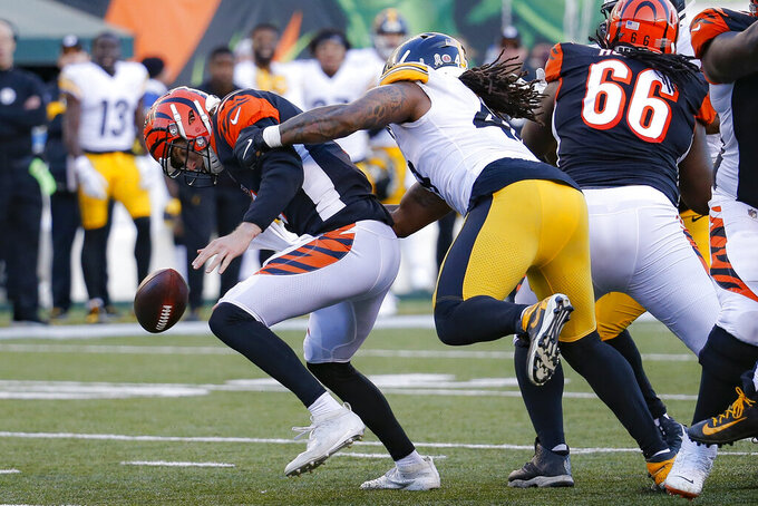 Pittsburgh Steelers outside linebacker Bud Dupree, right, forces a fumble the fumble off Cincinnati Bengals quarterback Ryan Finley, left, before recovering the ball for a turnover during the second half an NFL football game, Sunday, Nov. 24, 2019, in Cincinnati. (AP Photo/Frank Victores)