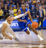 Seton Hall guard Quincy McKnight, right, drives to the basket against Marquette guard Markus Howard, left, during the second half of an NCAA college basketball game Saturday, Jan. 12, 2019, in Milwaukee. (AP Photo/Darren Hauck)