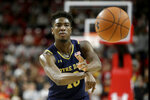 Notre Dame guard TJ Gibbs passes to a teammate against Maryland during the first half of an NCAA college basketball game, Wednesday, Dec. 4, 2019, in College Park, Md. (AP Photo/Julio Cortez)