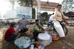 A local vendor sells traditional noodles on a sidewalk in front of the Sihanoukville Referral Hospital in Sihanoukville province, southwestern Phnom Penh, Cambodia, Friday, Nov. 1, 2019. (AP Photo/Heng Sinith)