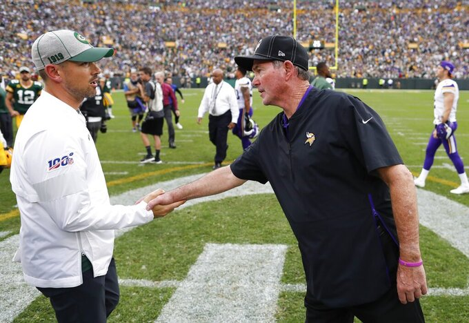 Minnesota Vikings head coach Mike Zimmer talks to Green Bay Packers head coach Matt LaFleur after an NFL football game Sunday, Sept. 15, 2019, in Green Bay, Wis. The Packers won 21-16. (AP Photo/Matt Ludtke)