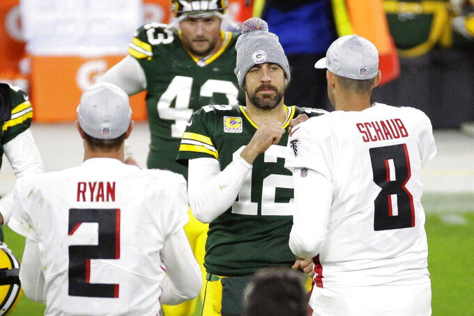 Green Bay Packers quarterback Aaron Rodgers (12) greets Atlanta Falcons quarterbacks Matt Ryan (2) and Matt Schaub (8) following an NFL football game, Monday, Oct. 5, 2020, in Green Bay, Wis. (AP Photo/Mike Roemer)