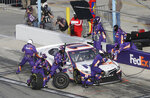 Denny Hamlin makes a pit stop during the NASCAR Cup Series road course auto race at Daytona International Speedway, Sunday, Feb. 21, 2021, in Daytona Beach, Fla. (AP Photo/Terry Renna)