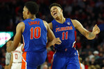 Florida forward Keyontae Johnson (11) and guard Noah Locke (10) celebrate late in the second half of the team's NCAA college basketball game against Georgia on Wednesday, March 4, 2020, in Athens, Ga. (Joshua L. Jones/Athens Banner-Herald via AP)