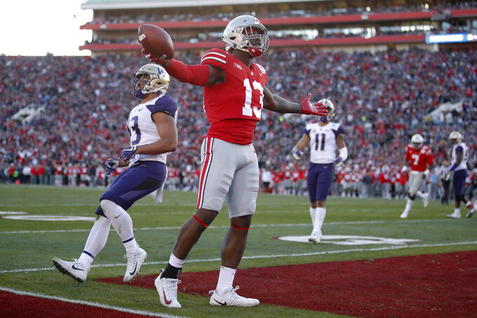 Ohio State tight end Rashod Berry celebrates after scoring against Washington during the first half of the Rose Bowl NCAA college football game Tuesday, Jan. 1, 2019, in Pasadena, Calif. (AP Photo/Jae C. Hong)