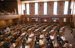 Oregon State Representatives congregate in the House, prior to the meeting being adjourned due to a COVID-19 exposure, during a special legislative session for redistricting congressional maps, Tuesday, Sept. 21, 2021 at the Oregon State Capitol in Salem, Ore.(Brian Hayes/Statesman-Journal via AP)