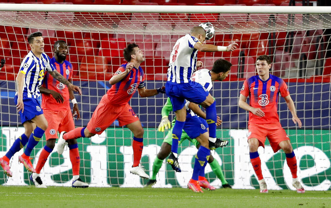 Porto's Pepe, centre, heads the ball during the Champions League, first leg, quarterfinal soccer match between FC Porto and Chelsea at the Ramon Sanchez-Pizjuan stadium in Seville, Spain, Wednesday, April 7, 2021. (AP Photo/Angel Fernandez)