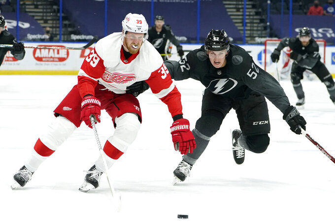 Detroit Red Wings right wing Anthony Mantha (39) gets around Tampa Bay Lightning defenseman Cal Foote (52) during the third period of an NHL hockey game Saturday, April 3, 2021, in Tampa, Fla. (AP Photo/Chris O'Meara)