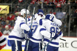 Tampa Bay Lightning players celebrate a goal by left wing Alex Killorn (17) during the second period of Game 3 of an NHL first-round hockey playoff series against the New Jersey Devils, Monday, April 16, 2018, in Newark, N.J. (AP Photo/Julio Cortez)