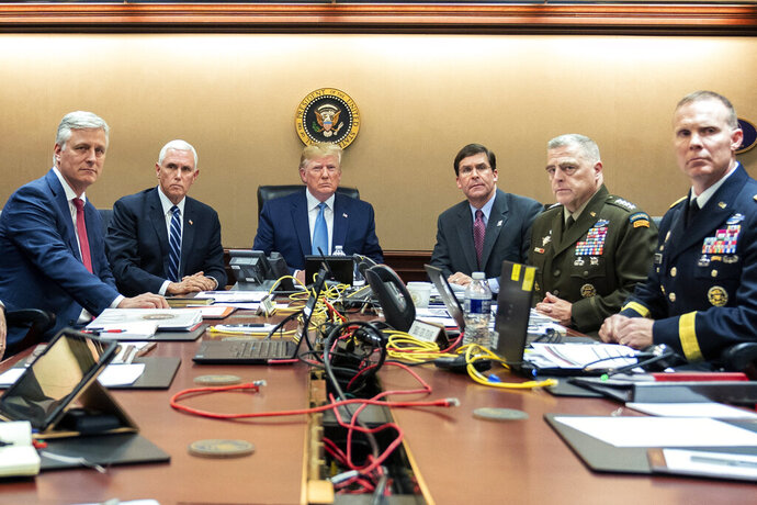In this photo provided by the White House, President Donald Trump is joined by from left, national security adviser Robert O'Brien, Vice President Mike Pence, Defense Secretary mark Esper, Joint Chiefs Chairman Gen. Mark Milley and  Brig. Gen. Marcus Evans, Deputy Director for Special Operations on the Joint Staff, Saturday, Oct. 26, 2019, in the Situation Room of the White House in Washington. monitoring developments as in the U.S. Special Operations forces raid that took out Islamic State leader Abu Bakr al-Baghdadi. (Shealah Craighead/The White House via AP)