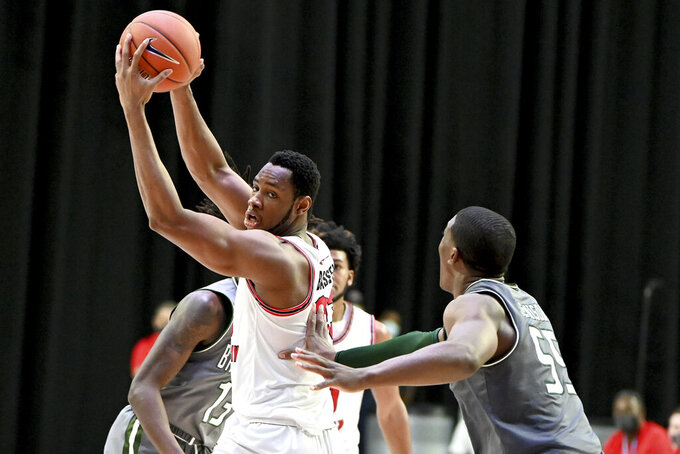 Western Kentucky center Charles Bassey (23) works for position on UAB center Trey Jemison (55) in the first half of an NCAA college basketball game in the Conference USA men's tournament, in Frisco, Texas, Friday, March 12, 2021. (AP Photo/Matt Strasen)