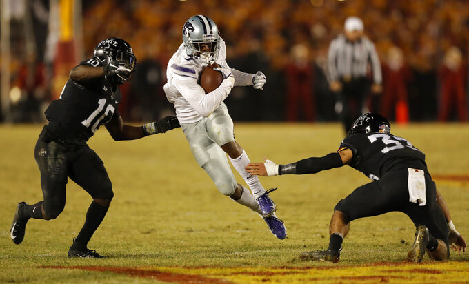 Kansas State wide receiver Isaiah Zuber, center, runs between Iowa State defenders Brian Peavy, left, and Braxton Lewis, right, after making a reception during the first half of an NCAA college football game, Saturday, Nov. 24, 2018, in Ames, Iowa. (AP Photo/Charlie Neibergall)