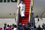 Pope Francis steps down as arrives at Military Air Terminal of Don Muang Airport, Wednesday, Nov. 20, 2019, in Bangkok, Thailand. (AP Photo/Gregorio Borgia)