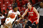 Maryland guard Kaila Charles, left, drives against Radford forward Savannah Felgemacher in the first half of a first round women's college basketball game in the NCAA Tournament, Saturday, March 23, 2019, in College Park, Md. (AP Photo/Patrick Semansky)
