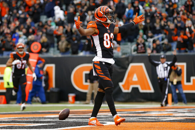 Cincinnati Bengals wide receiver Tyler Boyd celebrates after catching a touchdown pass during the first half of an NFL football game against the New York Jets, Sunday, Dec. 1, 2019, in Cincinnati. (AP Photo/Frank Victores)