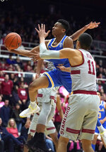 UCLA guard Jaylen Hands (4) drives to the basket in front of Stanford forward Jaiden Delaire (11) during the first half of an NCAA college basketball game Saturday, Feb. 16, 2019, in Stanford, Calif. (AP Photo/Tony Avelar)