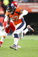 Denver Broncos defensive end DeMarcus Walker (57) covers a kickoff return during an NFL game against the Kansas City Chiefs, Thursday, Oct. 17, 2019, in Denver. The Chiefs defeated the Broncos 30-6. (Margaret Bowles via AP)