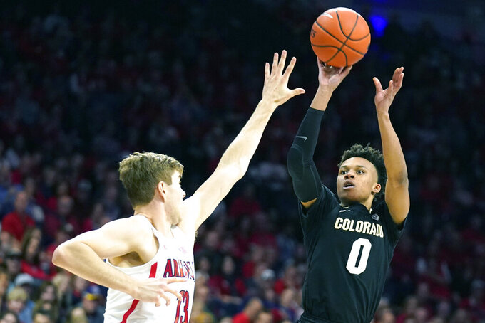 Colorado guard Shane Gatling (0) shoots over Arizona forward Stone Gettings during the first half of an NCAA college basketball game Saturday, Jan. 18, 2020, in Tucson, Ariz. (AP Photo/Rick Scuteri)