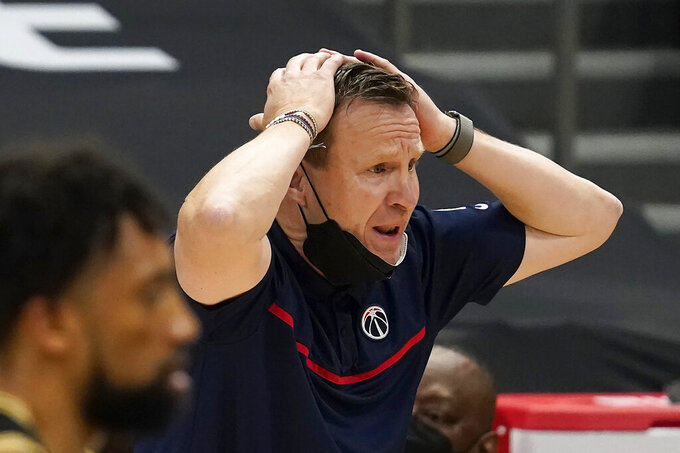 Washington Wizards head coach Scott Brooks reacts to an official's call during the second half of an NBA basketball game against the Toronto Raptors Thursday, May 6, 2021, in Tampa, Fla. (AP Photo/Chris O'Meara)