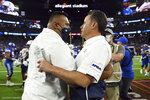 BYU coach Kalani Sitake, left and Arizona coach Jedd Fisch embrace after BYU's victory in an NCAA college football game Saturday, Sept. 4, 2021, in Las Vegas. (AP Photo/David Becker)