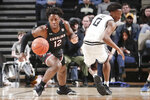 South Carolina's Trae Hannibal (12) chases down the ball after stealing it from Vanderbilt's Saben Lee (0) in the first half of an NCAA college basketball game Saturday, March 7, 2020, in Nashville, Tenn. (AP Photo/Mark Humphrey)