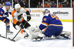 New York Islanders goaltender Semyon Varlamov (40) stops a shot on goal by Philadelphia Flyers' Chris Stewart (44) during the first period of an NHL hockey game Sunday, Oct. 27, 2019, in Uniondale, N.Y. (AP Photo/Frank Franklin II)