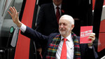 Jeremy Corbyn, Leader of Britain's opposition Labour Party waves upon arriving for the launch of Labour's General Election manifesto, at Birmingham City University, England, Thursday, Nov. 21, 2019. Britain goes to the polls on Dec. 12. (AP Photo/Kirsty Wigglesworth)