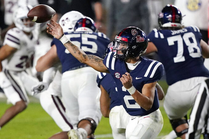 Mississippi quarterback Matt Corral throws a pass against Mississippi State during the second half of an NCAA college football game, Saturday, Nov. 28, 2020, in Oxford, Miss. Mississippi won 31-24. (AP Photo/Rogelio V. Solis)