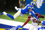 FILE - Los Angeles Rams cornerback Jalen Ramsey (20), top, stops a pass intended for Arizona Cardinals wide receiver DeAndre Hopkins (10) during an NFL football game in Inglewood, Calif., in this Sunday, Jan. 3, 2021, file photo. Hopkins was selected Friday, Jan. 8, 2021, to The Associated Press All-Pro Team. (AP Photo/Kyusung Gong, File)